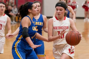 Northwestern's Emma Propfe (13) drives to the basket past Gilbert's Angelina Delacruz (11) during their Berkshire League semi-final game Tuesday at Northwestern Regional High School in Winsted. Jim Shannon Republican American