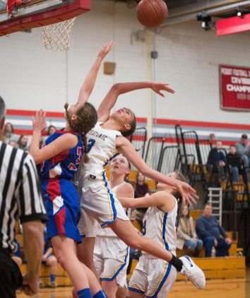 Housatonic's Sydney Segalla (13) blocks a shot of Nonnewaug's Maddie Woodward (34) during their Berkshire League semi-final game Tuesday at Northwestern Regional High School in Winsted. Jim Shannon Republican American