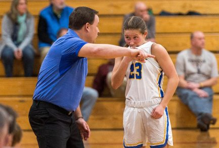 Housatonic head coach Steve Dodge gives instructions to Christina Winburn (23) during a break in the action of their Berkshire League semi-final game against Nonnewaug Tuesday at Northwestern Regional High School in Winsted. Jim Shannon Republican American