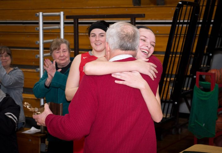 Northwestern's Emma Propfe gets a congratulatory hug from coach Fred Williams after being named recipient of the Edward B. Kolakowski Award Tuesday night at Northwestern Regional High School in Winsted. Jim Shannon Republican American