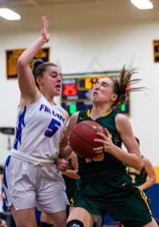 Holy Cross' Alyssa Hebb #10 drives hard to the basket against St Paul's Emma Cratella #5, during the NVL girls basketball final between Holy Cross and St Paul at Kennedy High School in Waterbury on Thursday. St Paul went on to win pulling away very late 57-51 and winning the NVL Conference Championship. Bill Shettle Republican-American