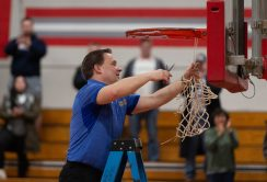 Housatonic head coach Steve Dodge cuts down the net following their win over Northwestern to capture the Berkshire League tournament title Friday at Northwestern Regional High School in Winsted. Jim Shannon Republican American