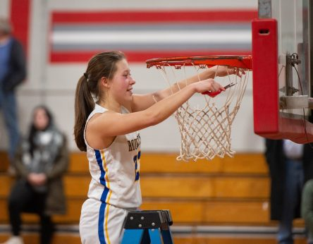 Housatonic's Christina Winburn (23) helps to cuts down the net following their win over Northwestern to capture the Berkshire League tournament title Friday at Northwestern Regional High School in Winsted. Jim Shannon Republican American