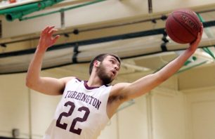 #22 Kevin Dixon of Torrington High hauls in a rebound against Crosby High during NVL semi final basketball action in Waterbury Monday. Steven Valenti Republican-American