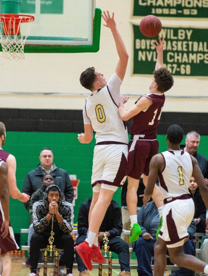 Torrington's Matt Rylander (14) gets his shot blocked by Sacred Heart'sConer Tierney (0) during their NVL tournament finals game held Wednesday at Wilby High School in Waterbury. Jim Shannon Republican American