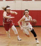 Pomperaug's Madison Villa (35) moves the ball on a fast break as Branford's Gabriella Lucertini (23) defends during the second round of the Class L tournament Thursday night at Pomperaug High School. Pomperaug defeated Branford 60-44. Michael Kabelka / Republican-American.