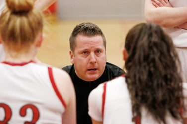 Pomperaug's coach Joe Fortier talks to his team during the second round of the Class L tournament Thursday night at Pomperaug High School. Pomperaug defeated Branford 60-44. Michael Kabelka / Republican-American.