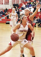 Pomperaug's Molly Flanagan (5) drives to the hoop as Branford's Gabriella Lucertini (23) defends during the second round of the Class L tournament Thursday night at Pomperaug High School. Pomperaug defeated Branford 60-44. Michael Kabelka / Republican-American.