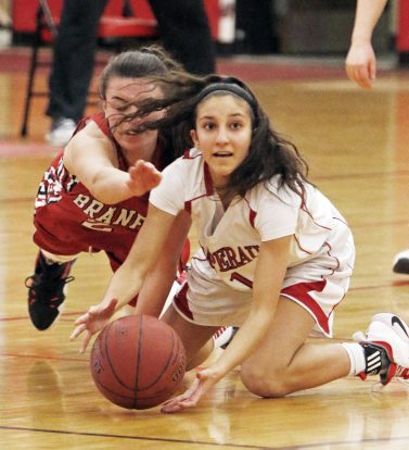 Pomperaug's Marina Lambiase (1) battles Branford's Lilly Moore-Markey (2) for the ball during the second round of the Class L tournament Thursday night at Pomperaug High School. Pomperaug defeated Branford 60-44. Michael Kabelka / Republican-American.