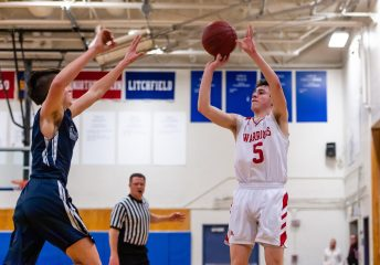 Reid Turtoro shoots during the BL Conference Tournament Championship game between Shepaug and Wamogo at Lewis Mills High School in Burlington on Friday. Bill Shettle Republican-American