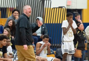 WCA head coach Ronan O'Leary punps his fist after his team hit a three-point basket during their Division II first round game against Enfield Tuesday at Kennedy High School in Waterbury . Jim Shannon Republican American