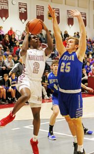 Naugatuck's Gwayne Fisher (2) puts up a shot as Newtown's Jack Mulligan (25) defends during the opening round of division III boys basketball tournament at Naugatuck High School Thursday night. Naugy defeated Newtown to advance. Michael Kabelka / Republican-American