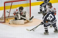 Watertown/Pomperaug's goalie Ryan Fleming #35 makes save on the shot from WMRP's Aaron Cholewa #27, during a Division II Hockey quarterfinal game between WMRP and Watertown/Pomperaug at Trinity College in Hartford on Friday. Bill Shettle Republican-American