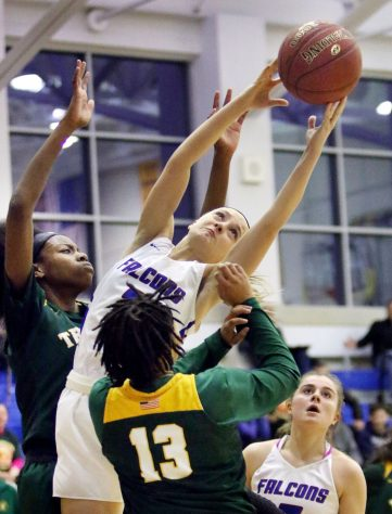 #2 Kailyn Bielecki of St. Paul Catholic pulls down the rebound over #15 Iyanna Lops and #13 Caitlyn Scott of Trinity Catholic during the CIAC Class S semi final in Newtown Friday. Steven Valenti Republican-American
