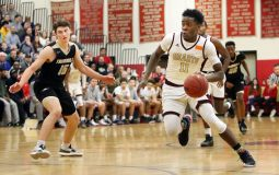 #11 Jamaal Waters of Sacred Heart High drives up the floor as #15 Chris Brown of Trumbull High defends during the CIAC quarterfinal in Southbury Monday. Steven Valenti Republican-American