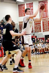 #0 Connor Tierney of Sacred Heart High looks to pass as #34 Evan Gutowski of Trumbull High defends during the CIAC quarterfinal in Southbury Monday. Steven Valenti Republican-American