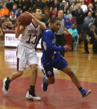 Torrington High School's CJ Root drives to the basket through West Haven High School's Tyrese Hargrove during the quarterfinals of the Division III boys varsity basketball tournament in Torrington on Monday, March 11, 2019. Emily J. Reynolds. Republican-American