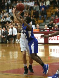 Torrington High School's Kevin Dixon battles West Haven High School's Quannel Straugher during the quarterfinals of the Division III boys varsity basketball tournament in Torrington on Monday, March 11, 2019. Emily J. Reynolds. Republican-American