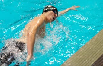 Northwestern's Alex Beauchene competes in the 200 freestyle during the State Open swim championships Thursday at Yale University. Jim Shannon Republican American
