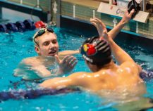Pomperaug's Bill Regan, left, is congratulated by Greenwich's Thomas Lewis after finishing first in the 200 IM during the State Open swim championships Thursday at Yale University. Jim Shannon Republican American