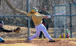 Woodland's Colby Linnell rips an RBI base hit during their scrimmage with Pomperaug Tuesday at Woodland Regional High School in Beacon Falls Jim Shannon Republican American