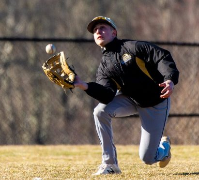 Woodland's Justin Butterworth make a running diving catch to end the inning during their scrimmage with Pomperaug Tuesday at Woodland Regional High School in Beacon Falls Jim Shannon Republican American