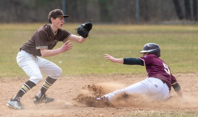 Sacred Heart's (5) safely steals second base in front of the tag by Thomaston's Brendan Fainer (6) during their non-league game Saturday at Thomaston High School. Jim Shannon Republican American