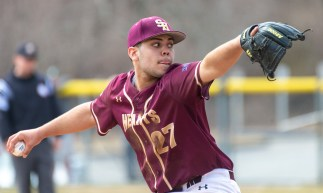 Sacred Heart's Hector Alejandro (27) delivers a pitch during their non-league game against Thomaston Saturday at Thomaston High School. Jim Shannon Republican American