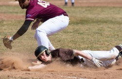 Thomaston's Brendan Fainer (6) dives back to first base in front of the tag by Sacred Heart's Ernest McClary (42) during their non-league game Saturday at Thomaston High School. Jim Shannon Republican American