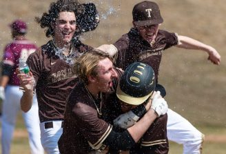 Thomaston's Isaiah Johnson (17), right, is mobbed by his teammates after he ripped a bases-loaded single in the bottom of the 7th inning, to give Thomaston a 2-1 win over Sacred Heart in their non-league game Saturday at Thomaston High School. Jim Shannon Republican American