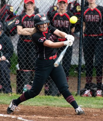 Cheshire's Brianna Pearson (11) rips a solo home run in the second inning to tie the game at 1-1 against Southington Tuesday at Cheshire High School. Jim Shannon Republican American