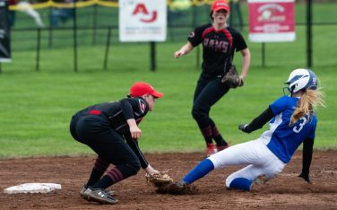 Cheshire's Mia Juodiatis (4) tags out Southington's Kelly Rose (3) as she tries to steal second base during their game Tuesday at Cheshire High School. Jim Shannon Republican American