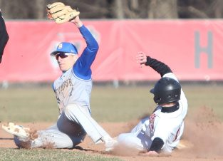 Pomperaug High School's Chase Chabot slides into second while Seymour High School's John Chacho comes down with the ball during the opening day boys varsity baseball game in Southbury on Monday, April 1, 2019. Emily J. Reynolds. Republican-American