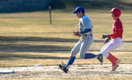 Gilbert's Evan Blass (11) races Wamogo's Colin Ferrer(9) to third base for the force out during their game Wednesday at Walker Field in Winsted. Jim Shannon Republican American
