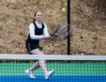 Thomaston's Emily Root returns a shot during her match with Houstaonic's Sayde Paulson Tuesday at Nystrom's Sports Complex in Thomaston. Jim Shannon Republican American