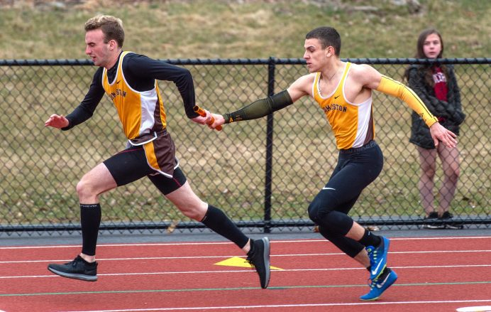 Thomaston's Benjamin Brickett, left takes the baton teammate Patrick Hyres, right, as they compete in the 4x100 meter relay during their Berkshire League meet with Housatonic Tuesday at Nystrom's Sports Complex in Thomaston. Jim Shannon Republican American