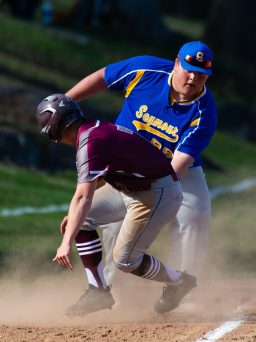 Naugatuck's Mike Patton (7) gets tagged out at third base by Seymour's Austin Verab (99) after aver running the bag during their game Wednesday at French Memorial Park in Seymour. Jim Shannon Republican American