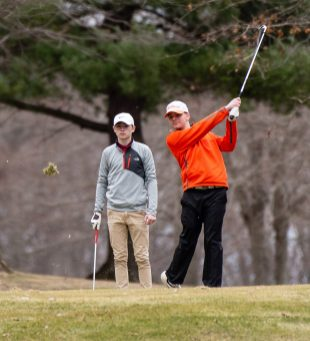 Watertown's Dave Aquavia tees off as Torrington's Brayden Nietch looks on during their match Thursday at Crestbrook Park in Watertown. Jim Shannon Republican American