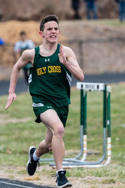Holy Cross' Randall Desauliniers sprints down the final stretch in the 1600m run, ahead of the entire field, during a a NVL Track and Field meet between Holy Cross, Oxford, and Seymour at Holy Cross High School in Waterbury on Friday. Bill Shettle Republican-American
