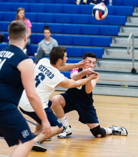 Oxford's John D'Ambruoso (6) and Ryan Reynolds (3) collide while both digging for the ball during their match with Joel Barlow Monday at Oxford High School. Jim Shannon Republican American