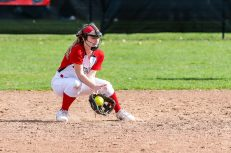 Pomperaug's Rachael Ushka #12 fields a ground ball hit to her, during a Girls SWC Softball game between Newtown and Pomperaug at Pomperaug High School in Southbury on Wednesday. Bill Shettle Republican-American