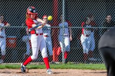 Pomperaug's Emma Durante #24 keeps her eye on the ball as she gets ready to hit it, during a Girls SWC Softball game between Newtown and Pomperaug at Pomperaug High School in Southbury on Wednesday. Bill Shettle Republican-American