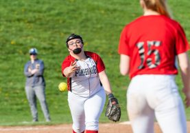Pomperaug pitcher Ella McCasland #34 throws the ball over to first base for an easy out, during a Girls SWC Softball game between Newtown and Pomperaug at Pomperaug High School in Southbury on Wednesday. Bill Shettle Republican-American