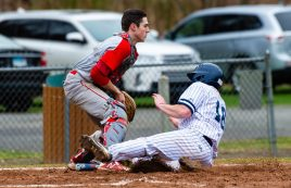 Shepaug's Chance Dutcher (18) comes in for the game-tying run in front of the tag by Northwestern's Trevor Grantmeyer (3) during their game Thursday at Tex Alex Field in Washington. Jim Shannon Republican American