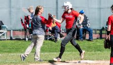 Northwestern's Jana Sanden #19 celebrates her home run with her coach Stacey Zematis, left, during a Girls BL Softball game between Northwestern and Wamogo at Wamogo High School in Litchfield on Wednesday. Northwestern beat their rival Wamogo 9-5. Bill Shettle Republican-American