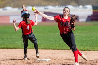 Wamogo's Savannah Wheeler #20 throws to first trying to complete a double play after getting the force out on Northwestern's Ellie Crone #4, during a Girls BL Softball game between Northwestern and Wamogo at Wamogo High School in Litchfield on Wednesday. Northwestern beat their rival Wamogo 9-5. Bill Shettle Republican-American