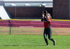 Northwestern outfielder Ellie Olsen #15 catches the ball in the outfield, during a Girls BL Softball game between Northwestern and Wamogo at Wamogo High School in Litchfield on Wednesday. Northwestern beat their rival Wamogo 9-5. Bill Shettle Republican-American