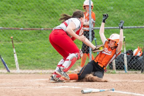 Wolcott catcher Lexi Boyce #13 tags out Terryville's Jessie Valentine #7 sliding into home plate, during a NVL Girls softball game between Terryville and Wolcott at Wolcott High School in Wolcott on Thursday. Bill Shettle Republican-American