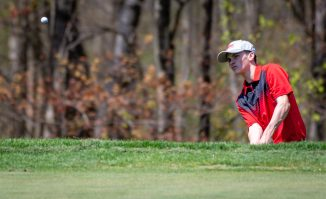 Northwestern's Brian Keegan chips onto the green during the Woodland Individual golf tournament held Thursday at Oxford Greens in Oxford. 20 schools from throughout the state completed in the tournament. Jim Shannon Republican American