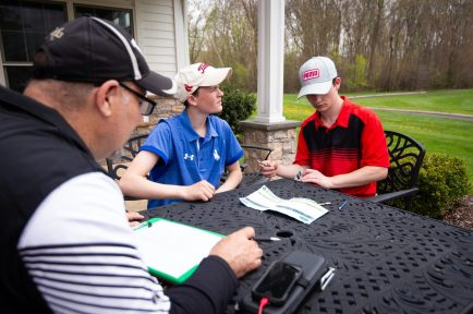 Woodland boys golf coach Bill Carangelo gets the score cards from Litchfield's Quinn Morse and Northwestern's Josh Cichocki following thier round in the Woodland Individual golf tournament held Thursday at Oxford Greens in Oxford. 20 schools from throughout the state completed in the tournament. Jim Shannon Republican American